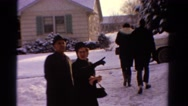 1958: people walking to their car in the winter time MINNESOTA Stock Footage