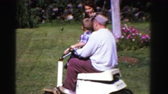 1958: dad teaching son lawnmowing on warm summer day MINNESOTA Stock Footage