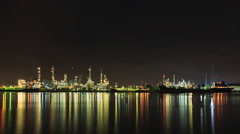 Bangchak Petroleum's oil refinery in Silhouette, beside the Chao Phraya River Stock Footage