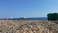 Pebble beach sea holiday Stock Footage