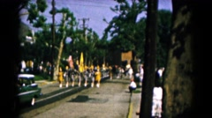 1961: parade marching band coming towards camera from far away HAGERSTOWN Stock Footage