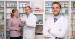 Optimistic Doctor Looking Camera Pharmacist Man Customer Woman Talk Background Stock Footage