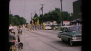 1961: parade down local street with many families watching HAGERSTOWN, MARYLAND Stock Footage