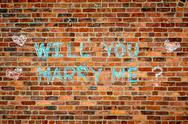 Brick wall with the text :  Wll you marry me? Stock Photos