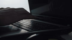 Close-up of a young man typing on a laptop keyboard Stock Footage