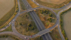 Busy four-way motorwayway intersection roundabout, pan around aerial shot Stock Footage