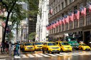 Yellow cabs next to Saint Patrick's Cathedra in New York City Stock Photos