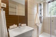 Small bathroom in brown idea Stock Photos