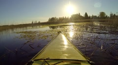 Kayak moving slowly over moss vegetation growing in the water Stock Footage