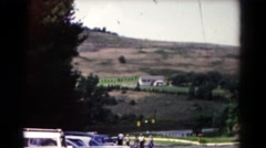 1961: roadside view of quaint farm located in valley surrounded by hills  Stock Footage