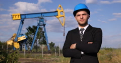 Oil Pump Unit Presentation American Businessman Looking Camera Fossil Resources Stock Footage