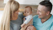 A happy family. Mother, father and son two months. Hold the baby in her arms Stock Footage