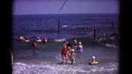 1961: mom and kids playing in the surf HAGERSTOWN, MARYLAND Stock Footage