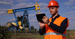 Successful Extracting Industry Worker Man Hold Touchpad Device Smiling Oil Pump Stock Footage