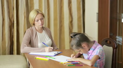 Child psychologist with a little girl. children's psychological counseling Stock Footage