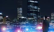 Businessman viewing night glowing city Stock Photos