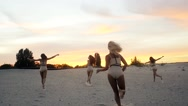 Group of Fore Teenage Girls Run at sunset in slow motion Stock Footage