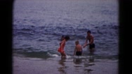 1961: people enjoying the beach on beautiful afternoon. HAGERSTOWN, MARYLAND Stock Footage