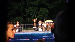 1961: summer public pool diving board jumping swimming HAGERSTOWN, MARYLAND Stock Footage
