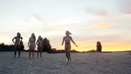 Girls Runs and jumps at sunset in slow motion Stock Footage