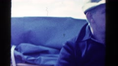 1958: two people on the back of boat in the ocean or large body of water Stock Footage