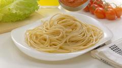 Putting tomato sauce on spaghetti Stock Footage