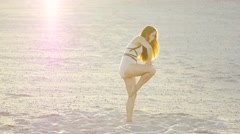 Professional dancer girl dancing Contempo at sunset in slow-motion Stock Footage