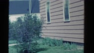 1958: view of suburban home and woman MINNESOTA Stock Footage