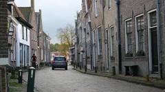 A man biking through the streets of a small European city. Stock Footage