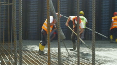 Group of workers concreting at building floor, armature in focus by Sheyno. Stock Footage
