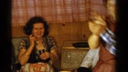1958: family dancing party in wood paneled basement MINNESOTA Stock Footage