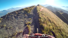 POV of a man mountain biking on a European mountainside biking trail. Stock Footage