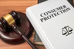 Consumer protection book and gavel. Law and regulations concept. Stock Photos