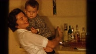 1958: mom talking to her son while holding him close MINNESOTA Stock Footage