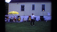 1958: man and child playing badminton at summer barbecue MINNESOTA Stock Footage