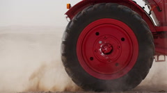 Red tractor in the desert egypt Stock Footage