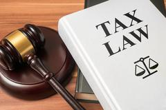 Tax law book and gavel. Consumer protection book and gavel. Law and regulatio Stock Photos