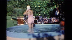 1958: outdoor above ground swimming pool summer play MINNESOTA Stock Footage