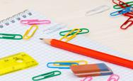 Simple pencil Notebook paper clips on a desk Stock Photos