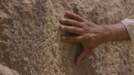 Hand touching the stones of the ancient Egypt pyramids Stock Footage