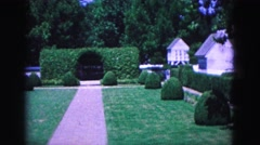 1964: outdoor gardens landscape wealthy home residents WILLIAMSBURG Stock Footage
