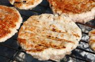 Chicken or turkey burgers for hamburger on grill Stock Photos