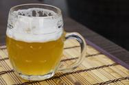 Glass mug of unfiltered weizen beer on table Stock Photos