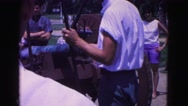 1964: man in blue and white is loading cannon put on cart WILLIAMSBURG Stock Footage