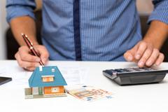 Property management concept, calculating house expenses Stock Photos