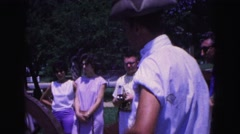 1964: us revolutionary war reenactor loading cannon front muzzle black powder Stock Footage