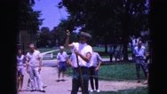 1964: guy in white priming rifle WILLIAMSBURG Stock Footage