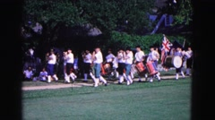 1964: band marches by with union flag. WILLIAMSBURG Stock Footage