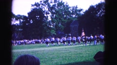 1964: solemn marching service across field as spectator watches action Stock Footage