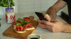 Clous up man sending text message in restaurant Stock Footage